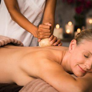 Mature woman having ayurvedic massage