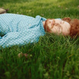 Portrait of a ginger man relaxing on the grass