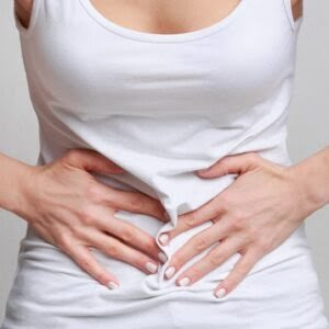 Woman with stomachache, having food poisoning, grey background
