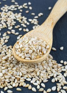 Sesame seeds on a Wooden Spoon