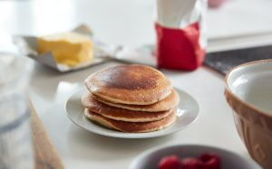 Stack Of Freshly Made Pancakes Or Crepes On Table For Pancake Day